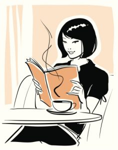 Women Reading Book at Cafe
